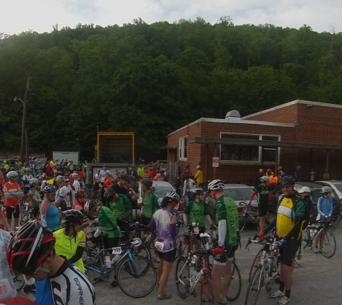 Riders assemble in front of the Newport Rec Center including those from Team Z (in green).